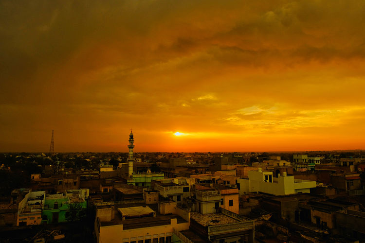Sunset over old town old Mandawa, India. ASIA India Mandawa, Rajasthan Old Town Architecture Building Building Exterior Built Structure City City Life Cityscape Cloud - Sky Crowded High Angle View Mandawa Nature Old City Orange Color Outdoors Residential District Romantic Sky Roof Sky Sun Sunset Town TOWNSCAPE