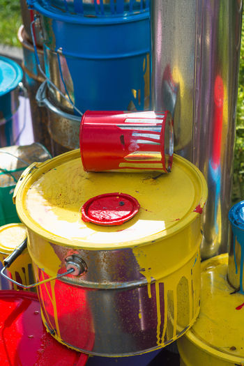 No People Red Yellow Container Close-up Still Life Focus On Foreground Indoors  Table Day Group Of Objects Multi Colored Metal Paint Retail  Kitchen Household Equipment Food And Drink