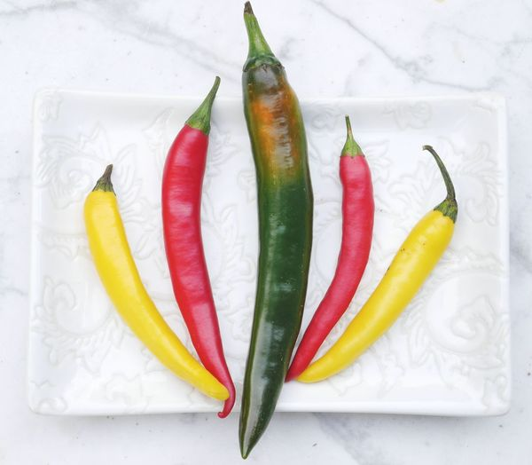 High angle view of chili peppers on table
