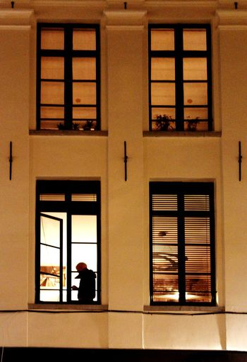 Window Architecture Building Exterior Looking Through Window Real People Lifestyles Adult Apartment Night Voyerism Shadows & Lights Nightlife Peeping Symmetry Open Window Closed Window  Four Windows Light From The Window The Graphic City
