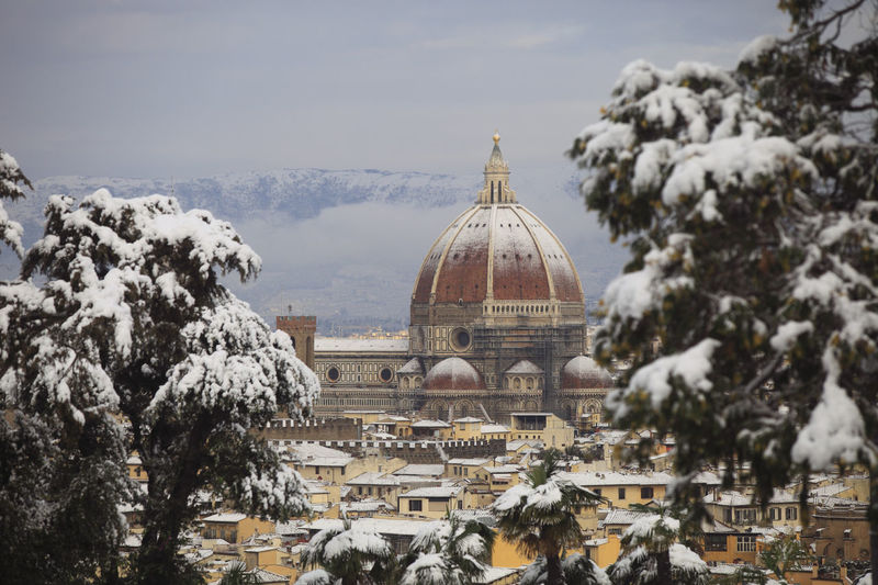 Florence with snow Architecture Building Exterior City Cupola Day Dome Government History No People Outdoors Politics Politics And Government Sky Travel Travel Destinations Tree