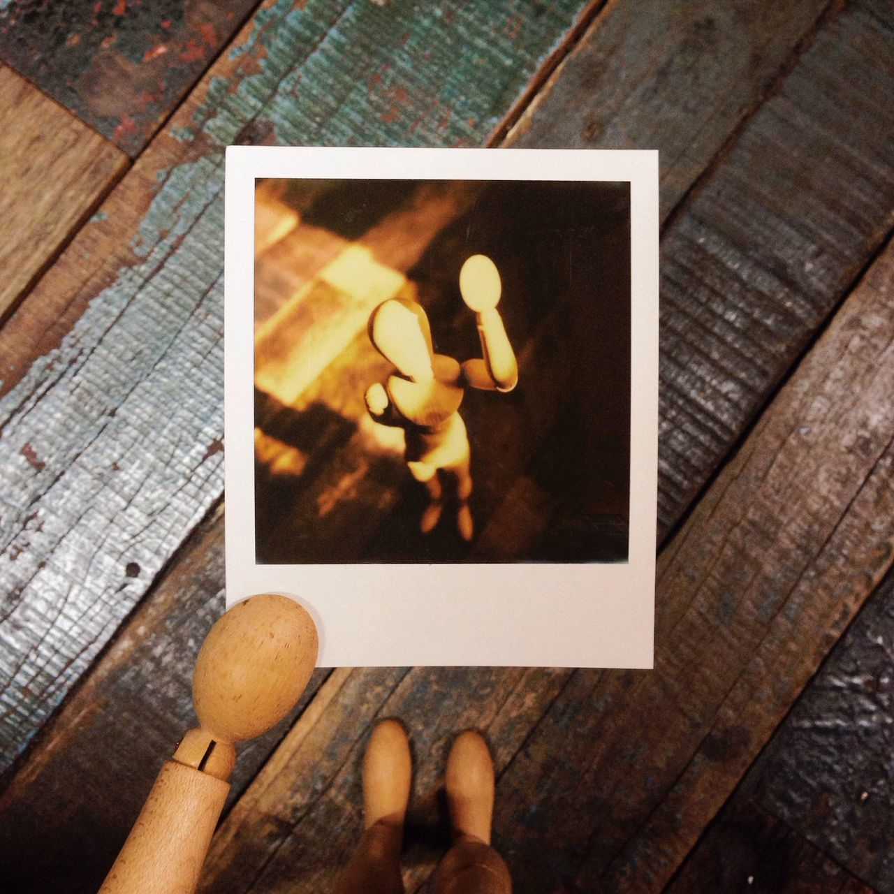 Close-up of instant photo picture of wooden human representation
