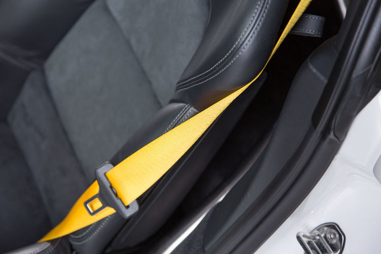 Close-up of yellow seat belt in car