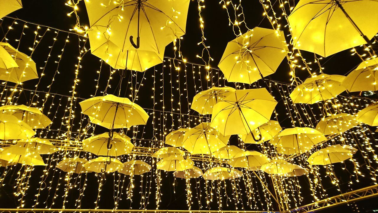 no people, close-up, decoration, night, lighting equipment, illuminated, wet, yellow, low angle view, drop, focus on foreground, glowing, hanging, water, indoors, light, electricity, rain
