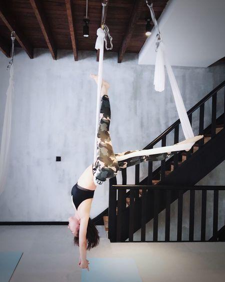 Full Length Of Woman Doing Rope Acrobatics