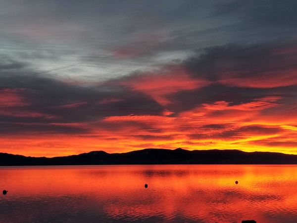 Sunrise on the West Shore of Tahoe was on fire this morning. #sunrise #reflection #lake #view Sunset Scenics Nature Landscape Beauty In Nature Water Tranquil Scene