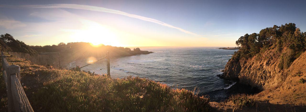 Coastline EyeEm Selects Water Sky Beauty In Nature Sea Scenics - Nature Sunset Lens Flare Beach Nature