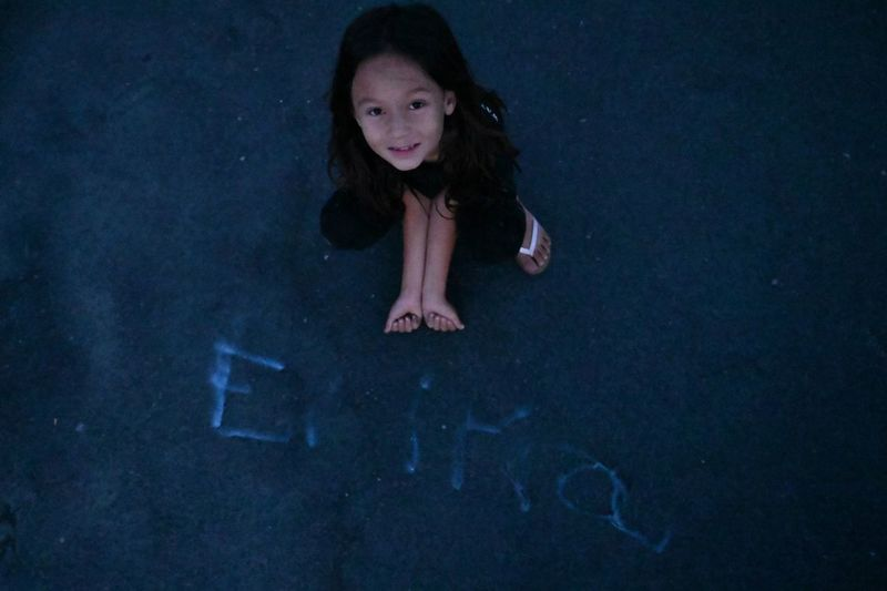 She wrote her name with fire from fireworks EyeEm Selects One Person Women Portrait Full Length Child Real People Childhood High Angle View Looking At Camera Emotion Leisure Activity Casual Clothing Lifestyles Adult Girls Offspring Females Indoors  Hairstyle