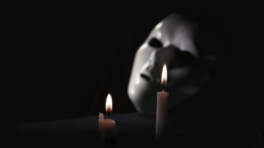 Mystique Masquerade mask with candles Antique Candle Jabbawockeez Mood Captures Candle Lit Dinner Flame Funeral Ghost Town Gloomy Horror Horror Photography Masquerade Mask Mystique Mystique Mask Scary Face White Mask