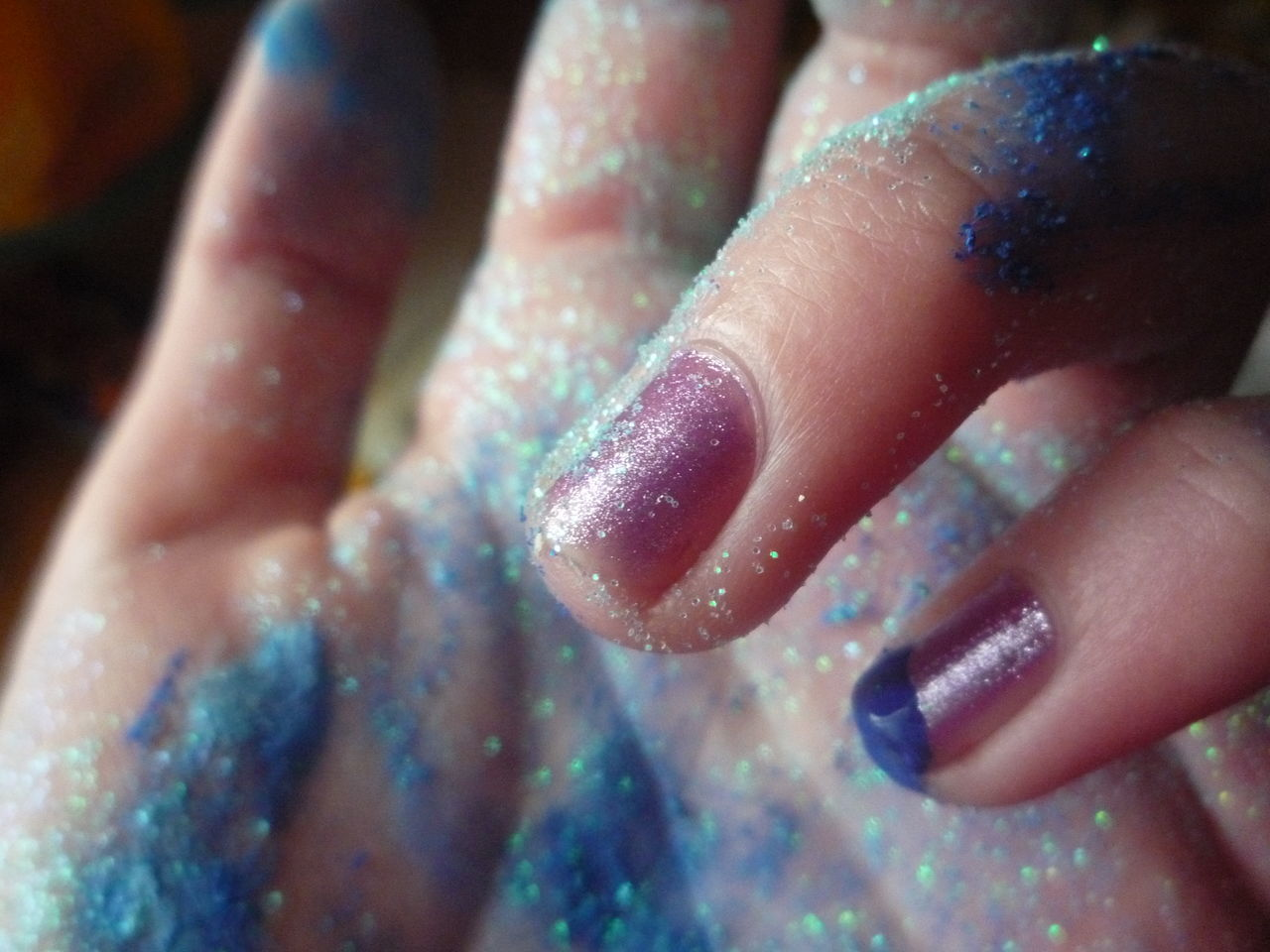 real people, human body part, one person, human finger, human hand, low section, lifestyles, close-up, human leg, fun, indoors, leisure activity, nail polish, multi colored, day, women, childhood, water, glitter, people, adult