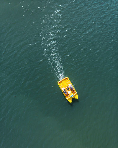 High angle view of people boating on sea