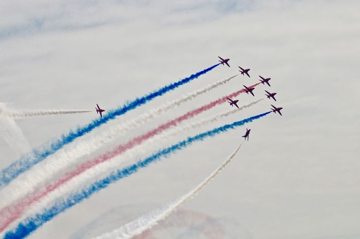 Red Arrows Air Display Aerobatics Airplane Airshow Cloud - Sky Day Fighter Plane Flying Motion No People on the move Plane Red Arrows Sky Speed Teamwork Transportation Vapor Trail Vapour Trail