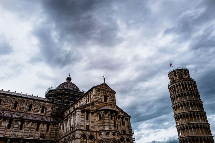 Church And Leaning Tower Of Pisa Against Sky
