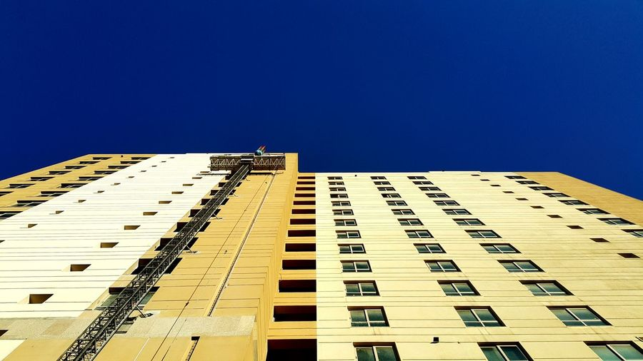 High section of building against clear sky