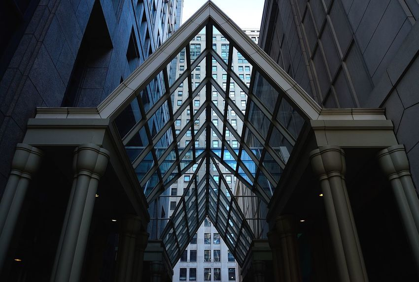 Adapted To The City Instagram: @iamjosway Architecture Low Angle View Ceiling Building Exterior Window Built Structure Modern No People Indoors  Day Detroit Michigan Motorcity Motorcityshooters Blue Glass Downtown The Street Photographer - 2017 EyeEm Awards The Architect - 2017 EyeEm Awards
