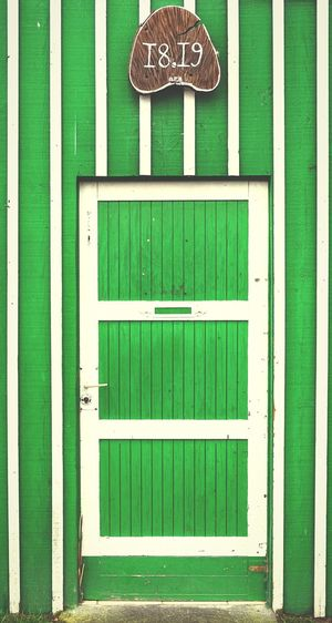 1819 Closed Door Built Structure Architecture No People Green Color Outdoors Building Exterior Day Close-up Barn Green Stripes Pattern Pattern EyeEm Best Shots Minimalism Parallel Lines Architectural Feature Architecture_collection Architectural Detail
