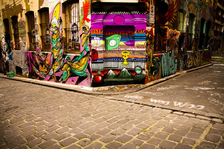 Multi Colored Footpath Art And Craft Street Creativity Architecture Built Structure No People City Graffiti Day Building Exterior Sidewalk Outdoors Cobblestone Variation Pattern Choice Market Craft Paving Stone