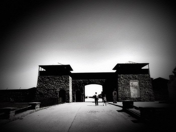 Gateway to death ..... Mathausen Sadness And Sorrow Memory Bnw_gateway2018 Bnw_friday_eyeemchallenge Silhouette Architecture Built Structure Full Length Adults Only Only Men Rear View