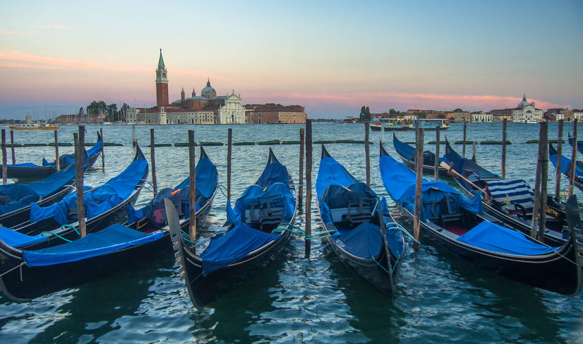 Gondolas moored on grand canal during sunset