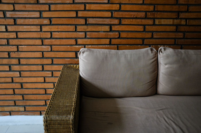 Basket Weave Brick Wall Close-up Day Furniture Home Interior Indoors  Living Room Modern No People Pattern Pillow Sofa Textured  Wall - Building Feature