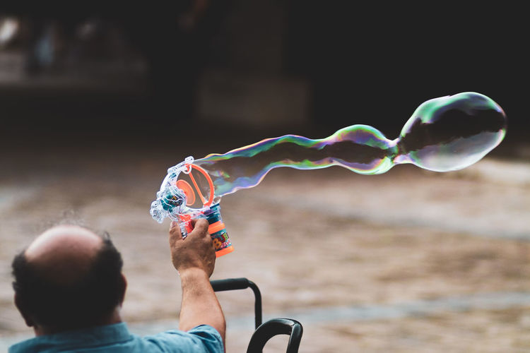 Portrait of man holding bubbles