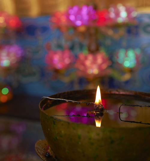 Close-up of illuminated lamp against blurred background