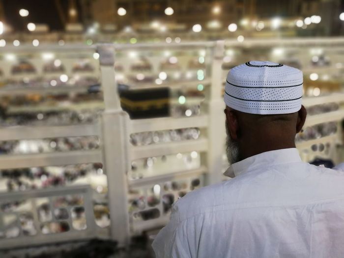 Muslims pray in front of the kaaba Rear View Headshot One Person Men Focus On Foreground Portrait Real People Hat Lifestyles Adult Indoors  Clothing Leisure Activity Cap Business Choice Architecture Retail  Males  Muslim Kaaba Mekah Prayertime Prayer Kaabah Umrah Hajj