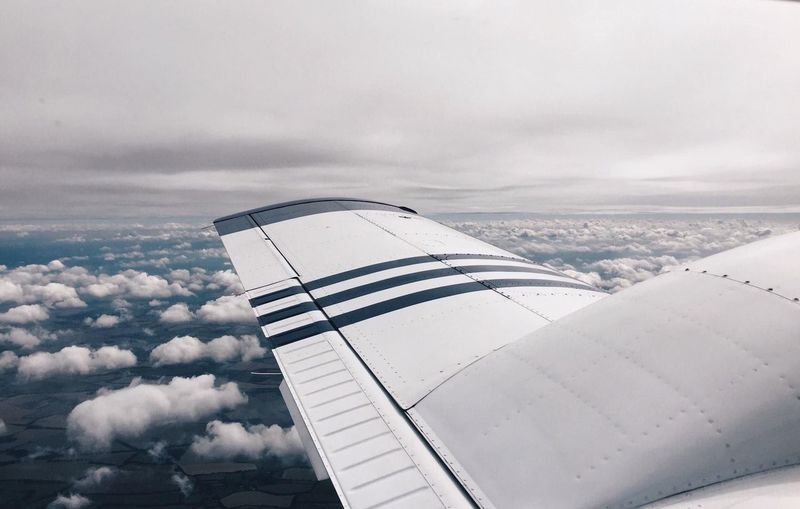 View of airplane wing while flying over Central America. No People Cloud - Sky Aerial View Aerial Aerial Shot Cloudscape Aircraft Wing Aerospace Industry Above on the move Flying Overcast Engine Travel Airplane Atmospheric Mood Horizon Over Land Solitude Atmosphere Copy Space High Angle View Central America Blue Sky Horizon Weather It's About The Journey