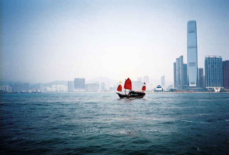 Architecture Asian  Boat City City Life Cityscape Harbour HongKong Mode Of Transport Modern Nautical Vessel No People Outdoors Sailing Ship Skyscraper Tall - High Travel Destinations Urban Skyline Water Waterfront