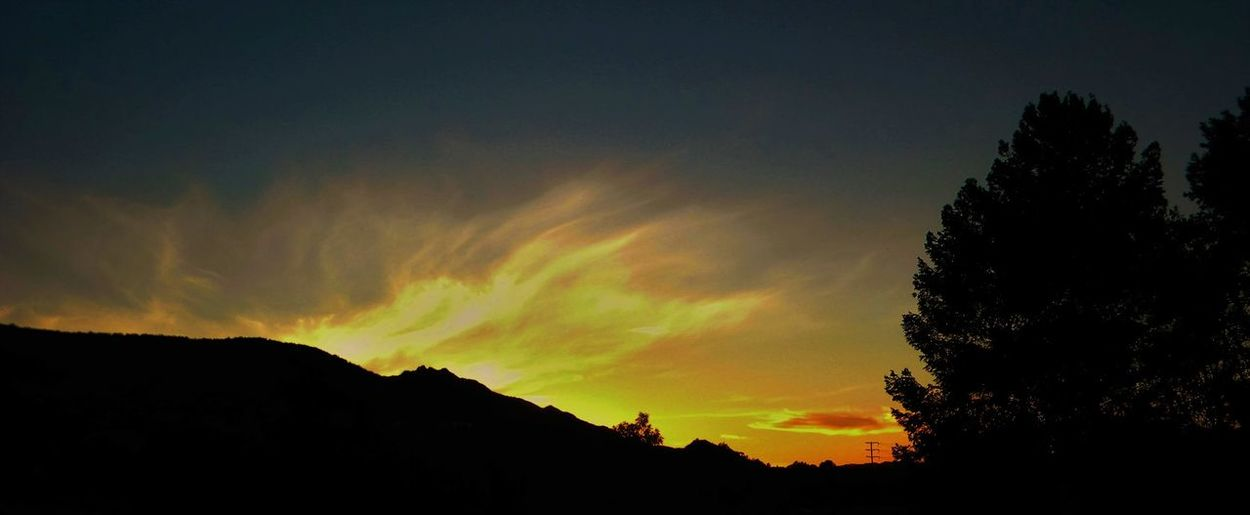 Low angle view of silhouette mountain against sky during sunset