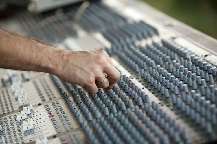 Close-up of hand using sound mixer