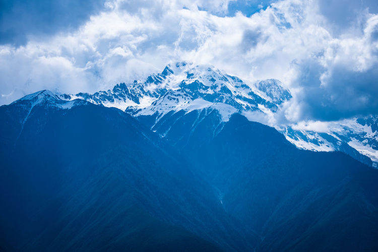 Mountain Sky Cloud - Sky Cold Temperature Winter Snow Environment Beauty In Nature Scenics - Nature Nature Mountain Range Snowcapped Mountain Landscape No People Tranquility Tranquil Scene Mountain Peak Non-urban Scene Outdoors Range Meili DeQin Yunnan China Tibet Fog Cold Cool