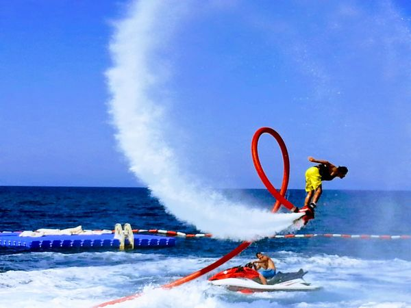 Sport Challenge Adventure Danger Extreme Sports Skill  Motion Speed One Man Only People Adult Headwear Spraying Only Men One Person Winter Sport RISK Adults Only Red Balance