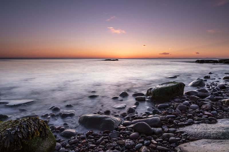 Seascape after sunset Beach Beauty In Nature Coast Horizon Horizon Over Water Land Long Exposure Motion Nature No People Orange Color Pebble Power In Nature Rock Rock - Object Scenics - Nature Sea Seascape Sky Solid Sunset Tranquil Scene Tranquility Water Waves