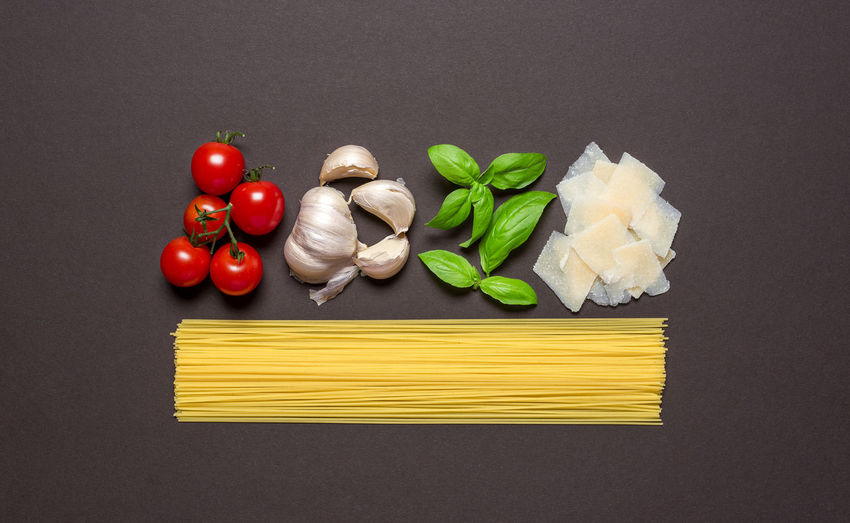 Directly above shot of various vegetables on black background