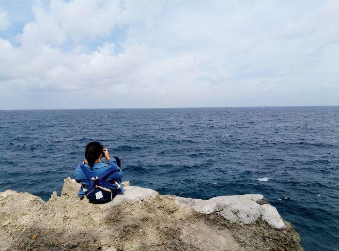 Alone Molucas Latuhalat Ambonmanise AmbonIsland Water Sea Full Length Sitting Beach Childhood Child Boys Adventure Sky
