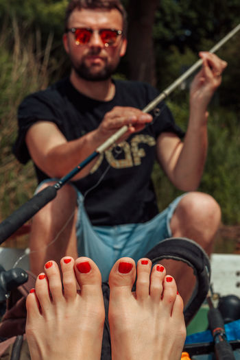 Close-up Day Fisherman Front View Leisure Activity Lifestyles Music Musician Nail Polish Nail Polish One Person Outdoors Playing Real People Woman Young Adult