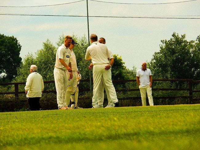 Grass Full Length Standing Adult Men Togetherness People Outdoors Sportsman Sports Clothing Cricket Lover Cricket Ball Cricket Field Cricket Match Cricketer Males  The Week On EyeEm Action Shot  Healthy Lifestyle Playing Field Lifestyles Winners Leisure Activity Adults Only