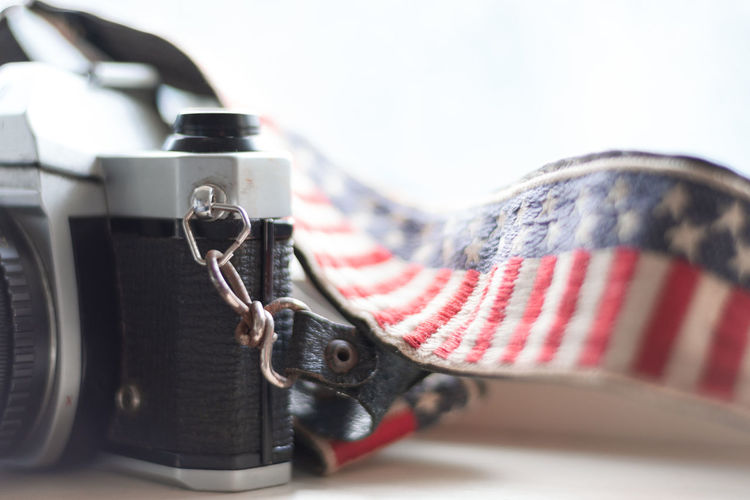 American photography Analogue Camera Camera Film America Camera Strap Close-up Film Camera Flag Focus On Foreground Indoors  Old Camera Patriotism Photography Themes Selective Focus Stars And Stripes Striped Studio Shot Technology White Background