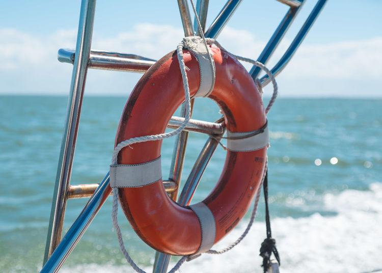 Close-up of red life buoy at sea