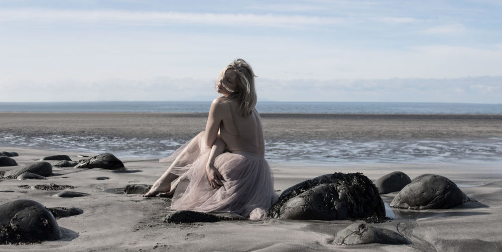 Talisker Beach in Scotland - Fine Art Photograph of a woman Canonphotography Canon EOS 750D Scotland Fine Art Photography The Great Outdoors - 2018 EyeEm Awards The Creative - 2018 EyeEm Awards Scenics Female Art Blonde Girl Stone Sensual_woman Sigma 30mm/1.4 Art Wind Talisker Bay Talisker Beach Water Sea Beach Sand Sky Horizon Over Water