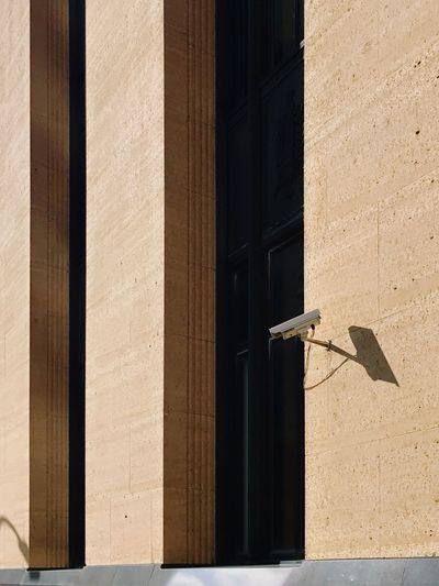 EyeEm Selects Sunlight Day Shadow Architecture Building Exterior No People Camera Security Camera Wall Stone Wall Architecture_collection Minimalobsession Urban Geometry Windows Minimalism Minimal Shadowplay