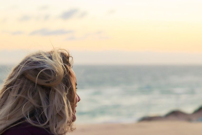 Where the winds take me. EyeEm Selects Beach Sea Long Hair Focus On Foreground One Person Sunset Wind Outdoors Headshot Sand Horizon Over Water Adult Vacations Close-up Nature Sky Portrait PortraitPhotography