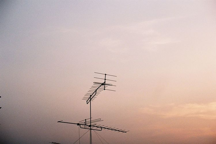 Old Sky Antenna - Aerial Communication Antenna Television Aerial Connection Low Angle View Cloud - Sky Outdoors Day Telecommunications Equipment Electricity  Technology Sunset Wireless Technology Power Supply No People High Section Nature Silhouette Architecture Global Communications