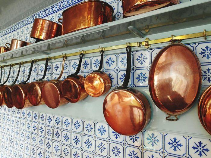 Copper Utensils On Wall