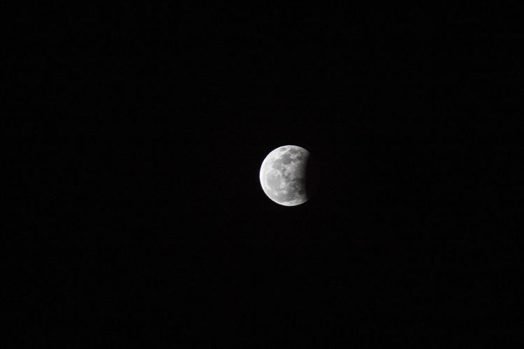 Lunar Eclipse Astronomy Beauty In Nature Discovery Half Moon Low Angle View Moon Moon Surface Nature Night No People Outdoors Planetary Moon Scenics Sky Space Space Exploration Tranquil Scene Tranquility The Week On EyeEm