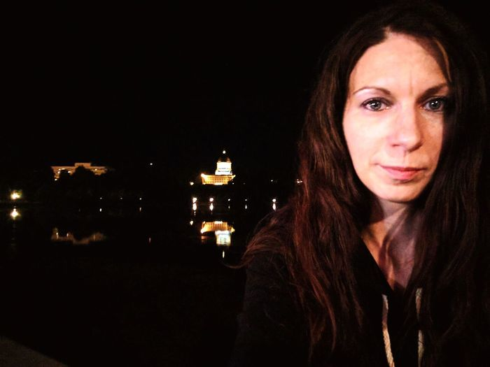 Feeling content One Woman Only One Person Brown Hair Portrait Looking At Camera Beautiful Woman Beauty Water Outdoors My State Capital Dome Capital Building Reflections Night Shot Eyeem Self Portrait Young Adult Black Background Night Adult Headshot Confidence