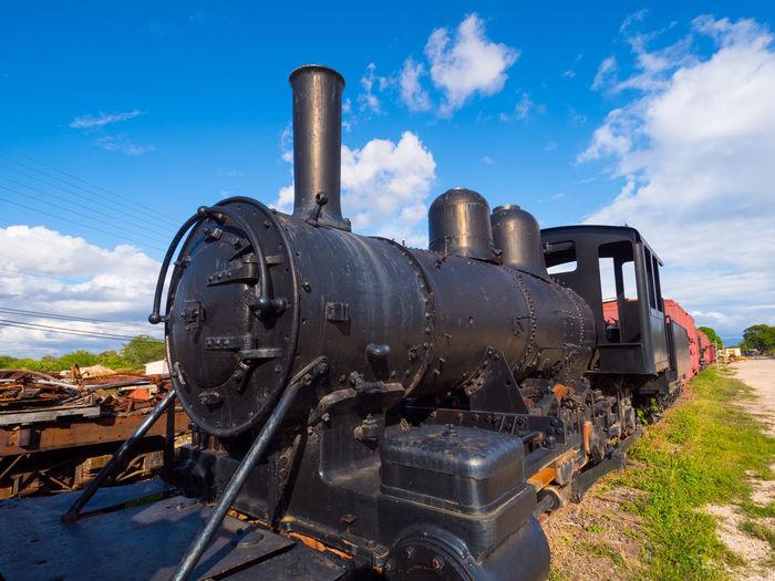 Steam train against sky