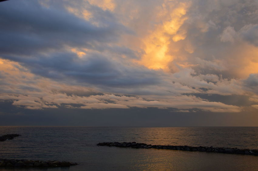 Sunset on the Mediterranean sea from the viewpoint of italy, with cloudy sky Cloudy Sky Mediterranean Sea Mediterranean Seascape Reflection Sunset On The Mediterranean Sea Sunset On The Mediterranean Sea From The Viewpoint Of Italy, With Cloudy Sky Beauty In Nature Cloud - Sky Cloudy Sky Background Horizon Horizon Over Water Motley Multicolored Nature No People Reflections In The Water Scenics - Nature Sea Sea And Sky Sky Sundown Sunset Tranquil Scene Tranquility Water
