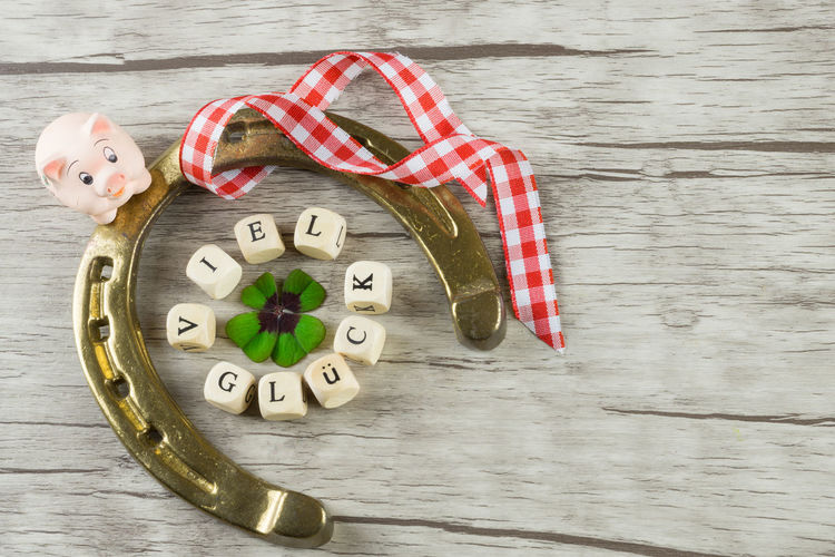 Close-up of horseshoe and christmas decorations on table